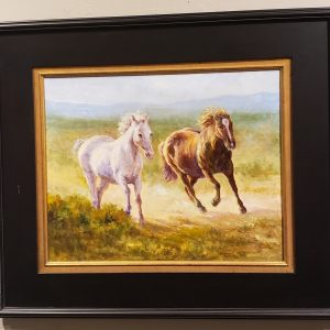 Oil painting of two horses running by Janet Loveless