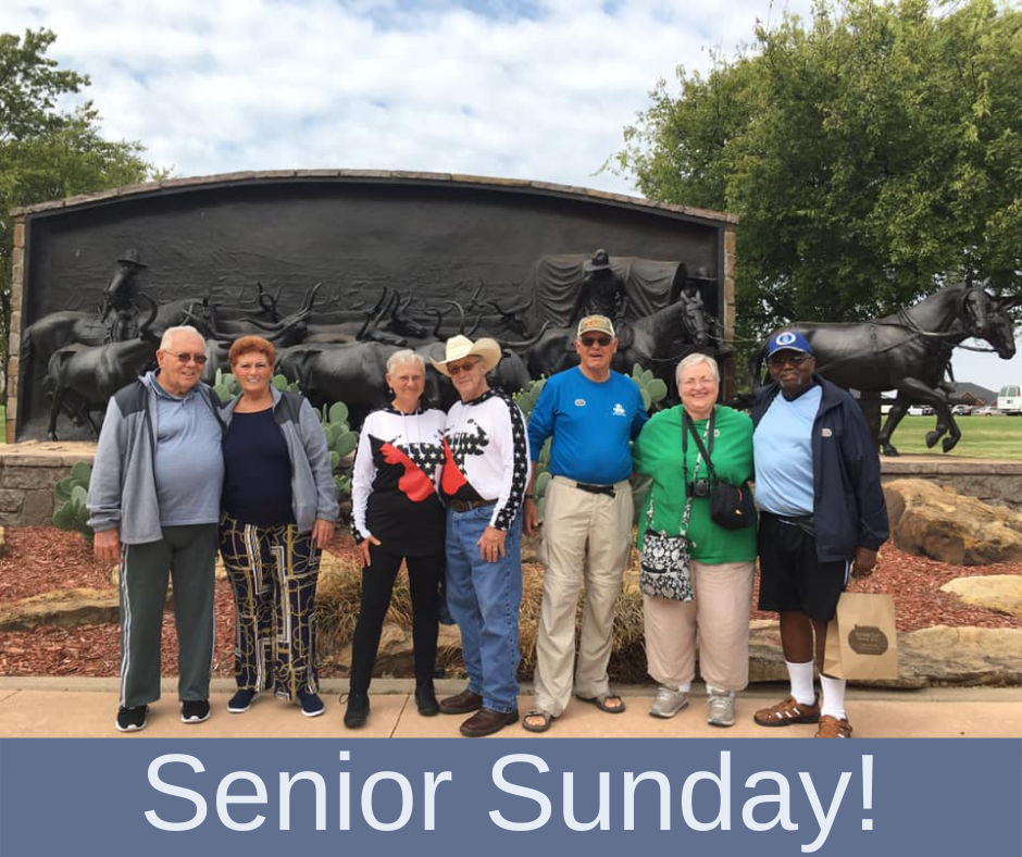 Group of seniors in front of Chisholm Trail Monument
